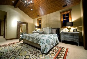 Eclectic Master Bedroom with Carpet, Arteriors bishop antique brass table lamp, Uttermost Langford Beveled Wall Mirror