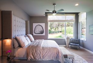 Contemporary Master Bedroom with flush light, Sunpan court armchair, Hardwood floors, Safavieh handmade malibu white shag rug