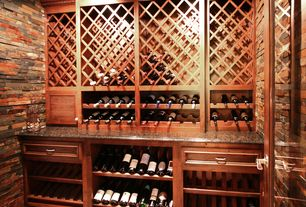 Traditional Wine Cellar with French doors, limestone tile floors, Built-in bookshelf