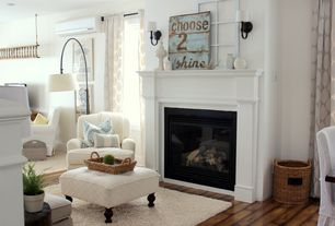 Cottage Living Room with metal fireplace, Hardwood floors, Pottery Barn Dalton Shag Rug Ivory, Cement fireplace, Wall sconce