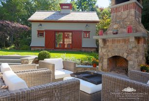 Country Patio with Barn door, exterior stone floors, French doors, Pathway