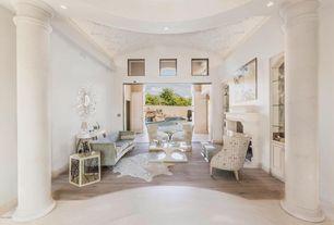 Transitional Living Room with Hardwood floors, Built-in bookshelf, Riverside Furniture Lyric Hexagon End Table, Columns