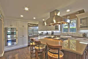 Traditional Kitchen with dishwasher, double wall oven, Simple granite counters, Farmhouse sink, Casement, Subway Tile