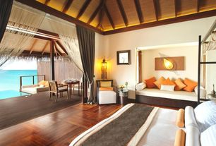 Tropical Master Bedroom with Window seat, Parquet hardwood floor, Exposed beam, Hardwood floors, Wall sconce, High ceiling