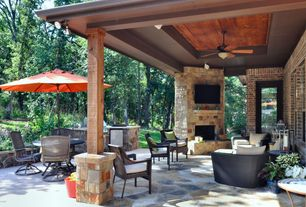 Modern Patio with French doors, Outdoor kitchen, Raised beds, exterior stone floors, Custom stone outdoor fireplace