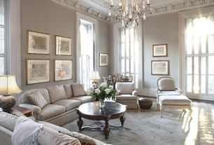 Living Room with Wainscotting, Wall sconce, Riverside delcastle round coffee table, Chandelier, specialty door, Carpet