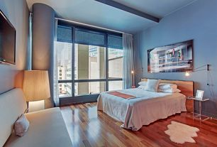Contemporary Master Bedroom with Hardwood floors, specialty window, picture window, High ceiling, Columns, Wall sconce