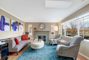 Eclectic Living Room with Laminate floors, picture window, Fireplace, Crown molding, Standard height, Casement