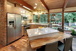 Contemporary Kitchen with Undermount sink, Limestone Tile, full backsplash, built-in microwave, Breakfast bar, L-shaped