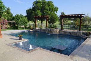 Craftsman Swimming Pool with exterior stone floors, Trellis, Pathway, Raised beds, Fence, Fountain, Pool with hot tub
