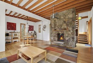 Modern Great Room with stone fireplace, Exposed beam, Glass panel door, High ceiling, double-hung window, Pendant light