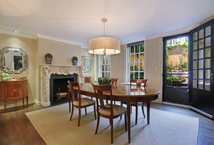 Traditional Dining Room with Cement fireplace, Fireplace, Hardwood floors, Crown molding, Pendant light, can lights