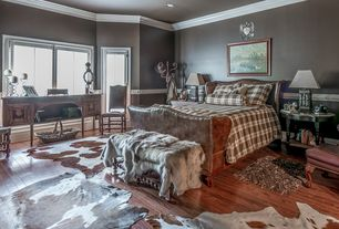 Eclectic Guest Bedroom with picture window, Chair rail, French doors, can lights, Hardwood floors, Crown molding