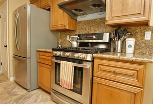 Traditional Kitchen with gas range, Standard height, Wall Hood, six panel door, sandstone tile floors, stone tile floors