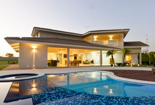 Modern Swimming Pool with Deck Railing, Pathway, Fence, Pool with hot tub, exterior stone floors, sliding glass door