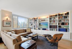 Contemporary Living Room with Built-in bookshelf, Wall sconce, Laminate floors