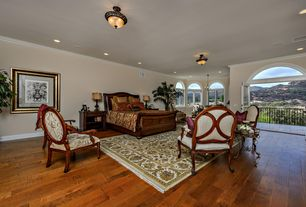 Mediterranean Master Bedroom with Hardwood floors, French doors, Arched window, flush light, Crown molding