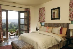 Mediterranean Guest Bedroom with Balcony, travertine tile floors, Surya Fargo Burnt Red Area Rug, French doors