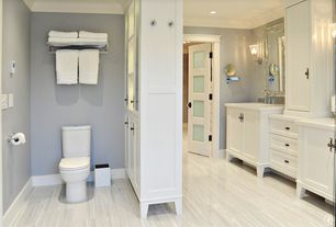 Cottage Full Bathroom with Corian counters, Flat panel cabinets, Ceramic Tile, Crown molding, specialty door, Wall sconce