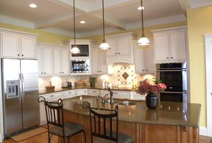 Traditional Kitchen with Flat panel cabinets, Kitchen island, Custom hood, Breakfast bar, Undermount sink, L-shaped