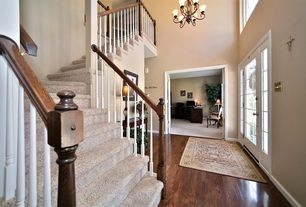 Traditional Entryway with picture window, High ceiling, Hardwood floors, French doors, Chandelier