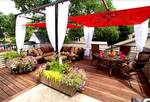 Contemporary Deck with Outdoor sectional, Outdoor seating, Curtain, Outdoor umbrella, Wood decking, Outdoor dining set