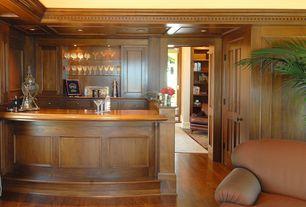 Traditional Bar with Built-in bookshelf, Hardwood floors, Ceiling cove lighting, Wood paneling