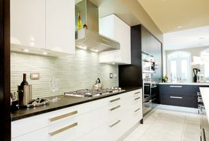 Modern Kitchen with Arched window, Salerno Mosaic Tile - Liberty Blend, Wall Hood, Kitchen island, Corian counters, Flush