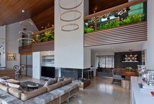 Contemporary Great Room with Concrete tile , Fireplace, can lights, sliding glass door, insert fireplace, Cathedral ceiling