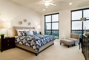 Modern Guest Bedroom with picture window, Ceiling fan, Carpet, can lights, Standard height