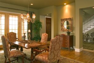 Traditional Dining Room with French doors, Hardwood floors, Chandelier