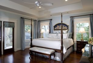 Traditional Master Bedroom with High ceiling, Glass panel door, can lights, Ceiling fan, picture window, Crown molding
