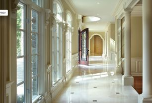 Traditional Hallway with Concrete floors, Arched window, Glass panel door, Wainscotting, Columns, Crown molding