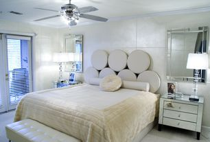 Art Deco Master Bedroom with Standard height, Carpet, Crown molding, French doors, Ceiling fan