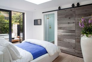 Contemporary Master Bedroom with Hardwood floors, French doors, can lights, Standard height