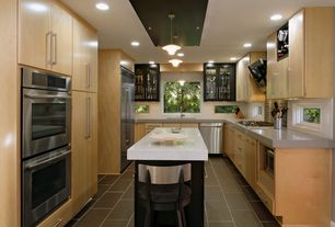 Contemporary Kitchen with Flush, Corian counters, Destiny: slab cabinets, Ceramic Tile, U-shaped, European Cabinets