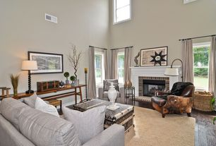 Eclectic Living Room with Cathedral ceiling, Built-in bookshelf, brick fireplace, double-hung window, Hardwood floors