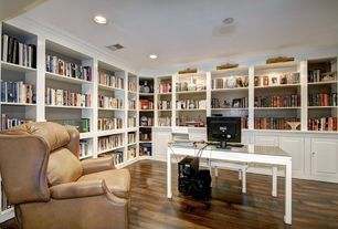 Traditional Home Office with Built-in bookshelf, Hardwood floors, can lights, Crown molding, Standard height
