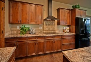 Craftsman Kitchen with specialty door, travertine tile floors, Stone Tile, Flat panel cabinets, Travertine Tile, L-shaped