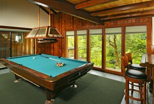 Traditional Game Room with Pendant light, stone tile floors, picture window, Exposed beam, soapstone tile floors