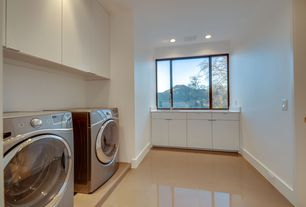 Contemporary Laundry Room with Undermount sink, Concrete tile , Daltile cement tile in parma, Built-in bookshelf