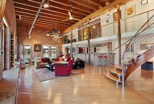 Contemporary Great Room with High ceiling, Chandelier, Wall sconce, Exposed beam, interior brick, can lights, Laminate floors