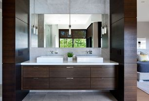 Contemporary Master Bathroom with can lights, Standard height, frameless showerdoor, Corian counters, stone tile floors
