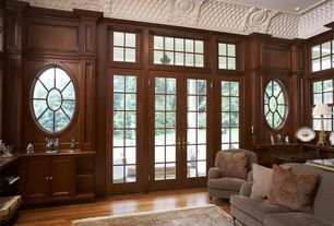 Traditional Home Office with Built-in bookshelf, Hardwood floors, Crown molding, French doors, Transom window