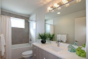 Contemporary Full Bathroom with Corian counters, Kovacs P5804-077 Chrome Bathroom Vanity Light, Dupont Corian Designer White