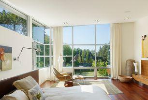 Modern Master Bedroom with Built-in bookshelf, picture window, Standard height, Hardwood floors, Columns, specialty window