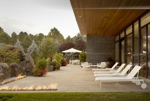 Contemporary Patio with Transom window, French doors, exterior tile floors, Fire pit
