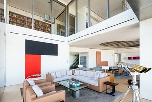 Contemporary Living Room with Loft, Laminate floors, Cathedral ceiling