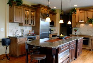 Country Kitchen with wall oven, warming oven, Glass panel, Limestone Tile, Framed Partial Panel, full backsplash, Custom hood