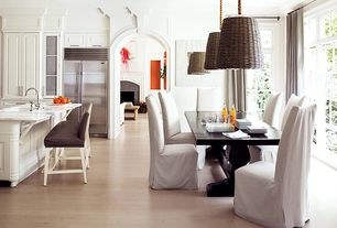 Traditional Dining Room with picture window, Pendant light, Standard height, Laminate floors